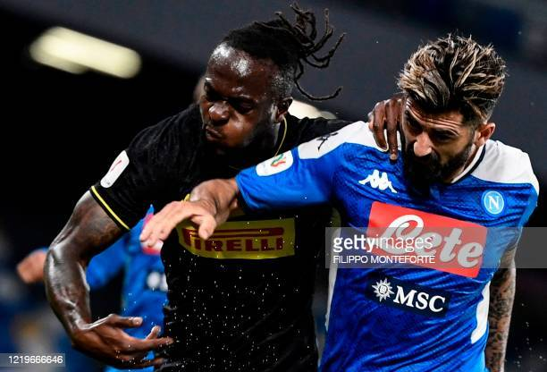 Napoli's Albanian defender Elseid Hysaj and Inter Milan's Nigerian defender Victor Moses go for the ball during the Italian Cup semifinal second leg...