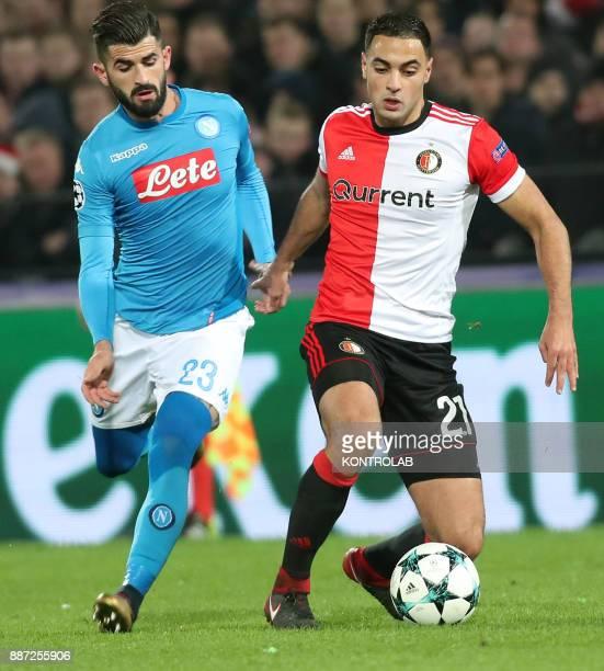 STADIUM ROTTERDAM NETHERLANDS Napoli's Albanian defender Elseid Hysaj fights for the ball with Feyenoord's Moroccan midfielder Sofyan Amrabat during...