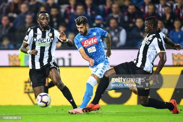 Napoli's Albanian defender Elseid Hysaj slips through Udinese's Ivorian midfielder Seko Fofana and Udinese's Ghanaian defender Nicholas Opoku during...