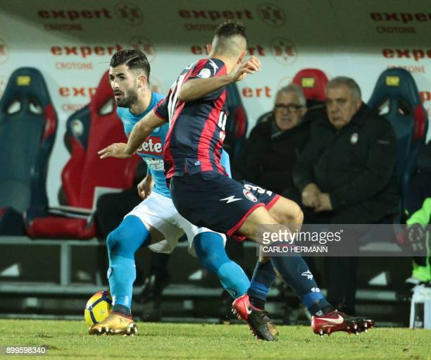 Napoli's Albanian defender Elseid Hysaj vies for the ball with Crotone's Italian defender Davide Faraoni during the Italian Serie A football match FC...
