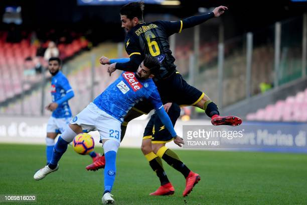 Napoli's Albanian defender Elseid Hysaj vies with Frosinone's defender Edoardo Goldaniga during the Italian Serie A football match between Napoli and...