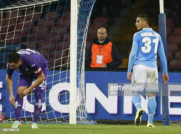 Napoli's Algerian defender Faouzi Ghoulam leaves the pitch after being expelled during the Italian Serie A football match between SSC Napoli and...