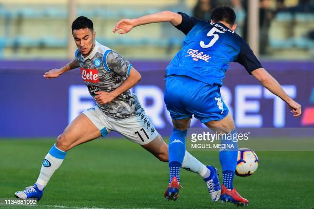 Napoli's Algerian forward Adam Ounas and Empoli's Albanian defender Frederic Veseli go for the ball during the Italian Serie A football match Empoli...