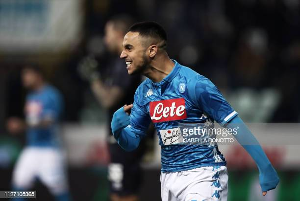 Napoli's Algerian forward Adam Ounas celebrates after scoring a goal during the Italian Serie A football match between Parma and Napoli at the Ennio...