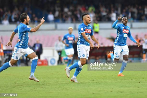 Napoli's Algerian forward Adam Ounas celebrates after scoring during the Italian Serie A football match Napoli vs Sassuolo at the San Paolo Comunal...