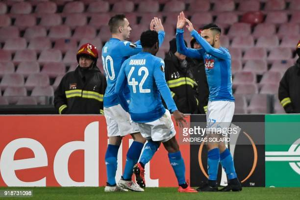 Napoli's Algerian forward Adam Ounas celebrates with teammates after scoring a goal during the UEFA Europa League football match between Napoli and...