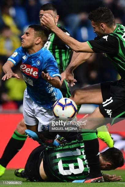 Napoli's Algerian forward Adam Ounas collides with Sassuolo's defender Gian Marco Ferrari and Sassuolo's defender Federico Peluso during the Italian...