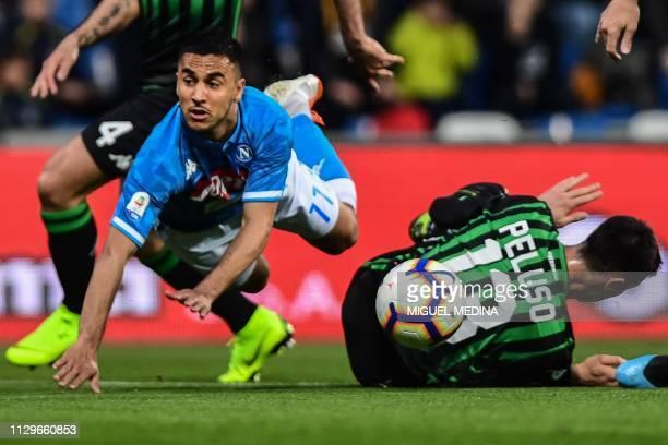 Napoli's Algerian forward Adam Ounas collides with Sassuolo's defender Federico Peluso during the Italian Serie A football match Sassuolo vs Napoli...
