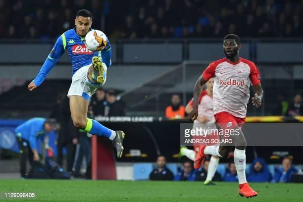 Napoli's Algerian forward Adam Ounas controls the ball next to Salzburg's French defender Jerome Junior Onguene during the UEFA Europa League round...