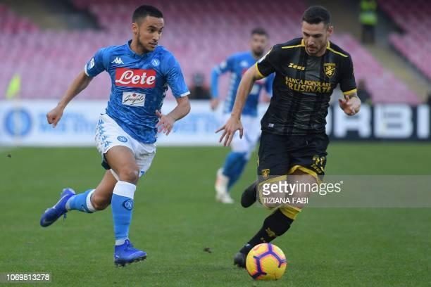 Napoli's Algerian forward Adam Ounas vies with Frosinone's Italian midfielder Andrea Beghetto during the Italian Serie A football match between...