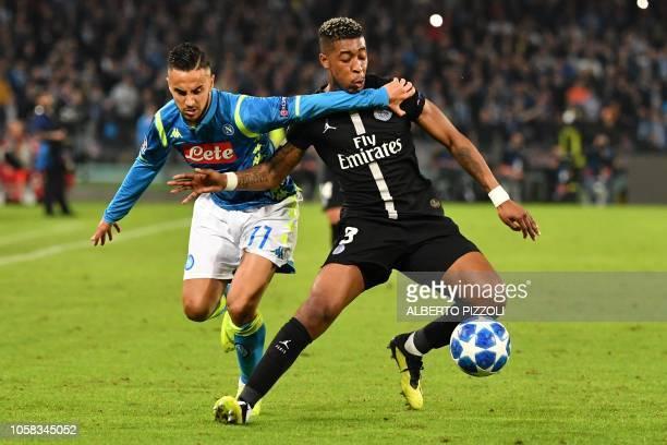 TOPSHOT Napoli's Algerian forward Adam Ounas vies with Paris SaintGermain's French defender Presnel Kimpembe during the European Champions League...
