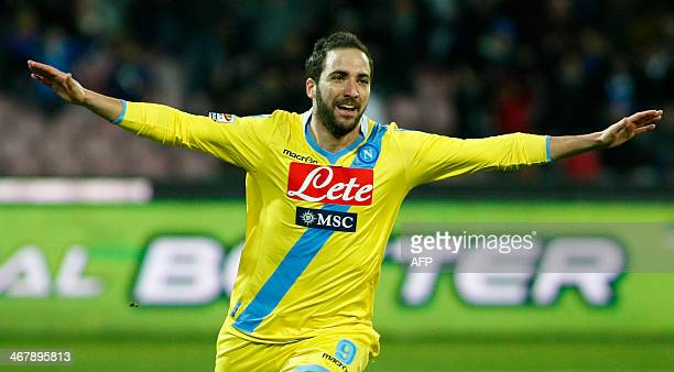 Napoli's Argentine forward Gonzalo Higuain celebrates after scoring a goal during the Italian Serie A football match between SSC Napoli and AC Milan...
