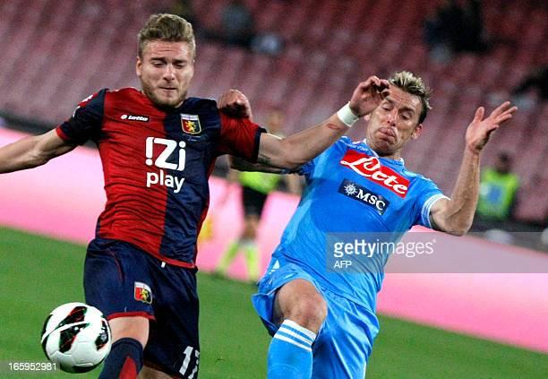 Napoli's Argentinian defender Hugo Campagnaro vies with Genoa's Italian forward Ciro Immobile during the Italian Serie A football match SSC Napoli vs...