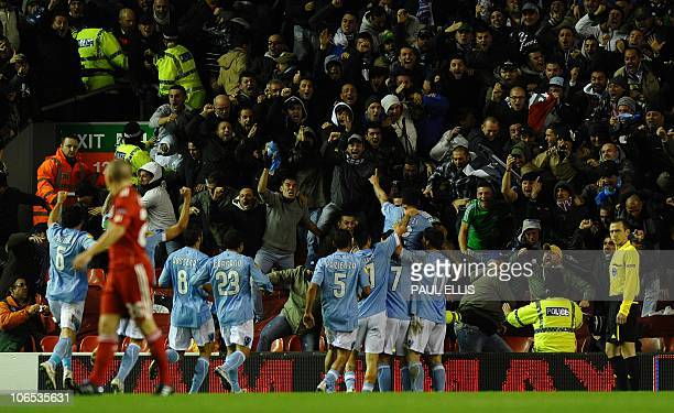Napoli's Argentinian forward Ezequiel Lavezzi celebrates with the crowd after scoring against Liverpool during their UEFA Europa League football...