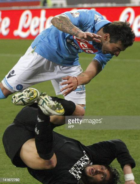Napoli's Argentinian forward Ezequiel Lavezzi fights for the ball with Siena's Italian defender Emanuele Pesoli during the return football match of...