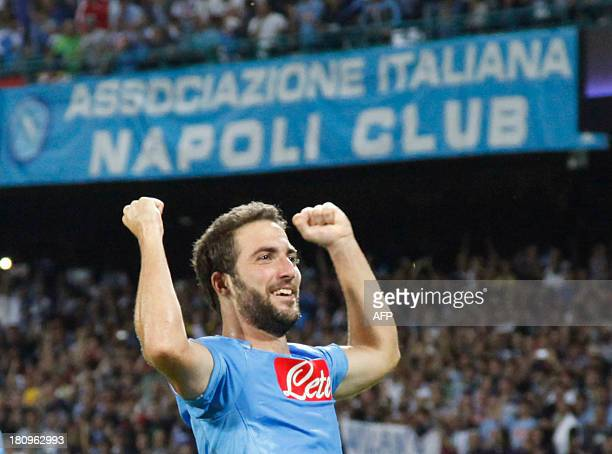 Napoli's Argentinian forward Gonzalo Higuain celebrates after scoring during the group F Champions League football match SSC Napoli vs Borussia...