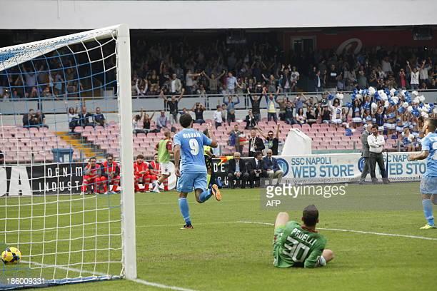 Napoli's Argentinian forward Gonzalo Higuain celebrates after scoring against Torino's goalkeeper Daniele Padelli during the Italian Serie A football...