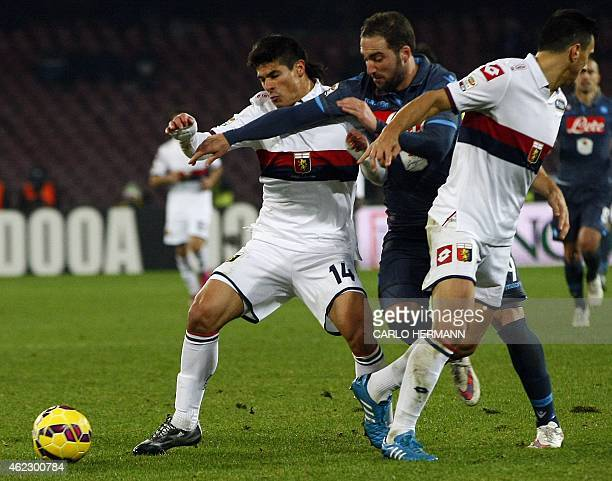 Napoli's Argentinian forward Gonzalo Higuain fights for the ball with Genoa's Argentinian defender Facundo Roncaglia during the Italian Serie A...