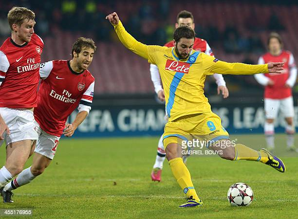 Napoli's Argentinian forward Gonzalo Higuain kicks to score during the UEFA Champion's League group F football match between SSC Napoli and Arsenal...