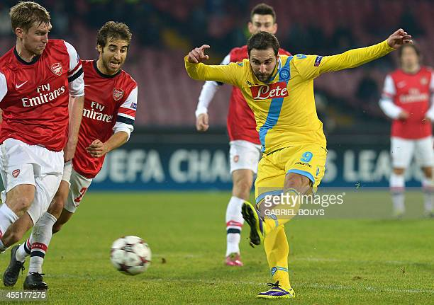Napoli's Argentinian forward Gonzalo Higuain scores during the UEFA Champion's League group F football match between SSC Napoli and Arsenal FC at the...