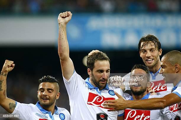 Napoli's Argentinian forward Gonzalo Higuain with teammates Italian forward Lorenzo Insigne Belgian forward Dries Mertens Spanish forward Michu and...