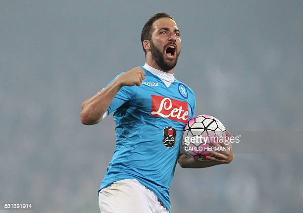 TOPSHOT Napoli's ArgentinianFrench forward Gonzalo Higuain celebrates after scoring his third goal during the Italian Serie A football match SSC...