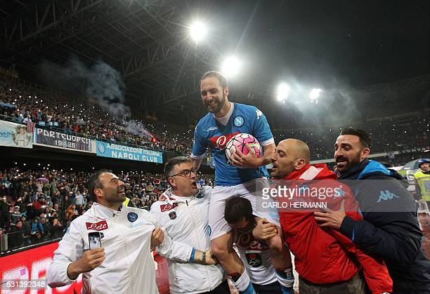 Napoli's ArgentinianFrench forward Gonzalo Higuain is carried by team mates at the end of the Italian Serie A football match SSC Napoli vs Frosinone...