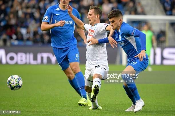 Napoli's Arkadiusz Milik and Genk's Ianis Hagi fight for the ball during the match between Belgian soccer team RC Genk and Italian club SSC Napoli...