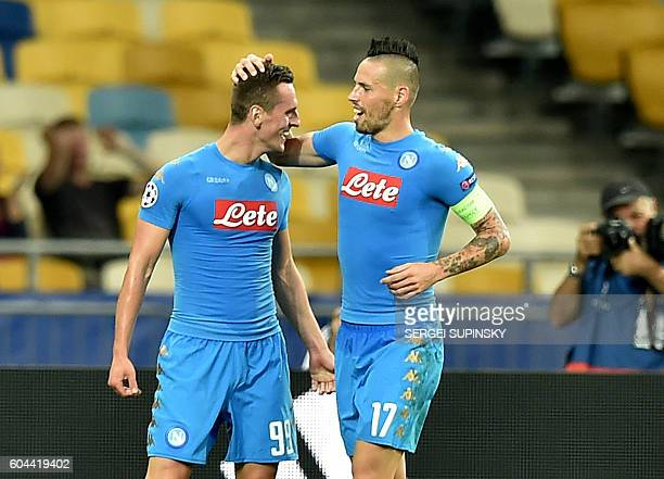 SSC Napoli's Arkadiusz Milik and Marek Hamsik celebrate after scoring a goal during the UEFA Champions League football match between FC Dynamo and...
