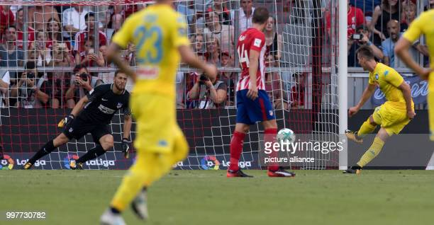 Napoli's Arkadiusz Milik shoots a penalty kick at Madrid's Jan Oblak's goal during the Audi Cup semifinal match pitting Atletico Madrid vs SSC Napoli...
