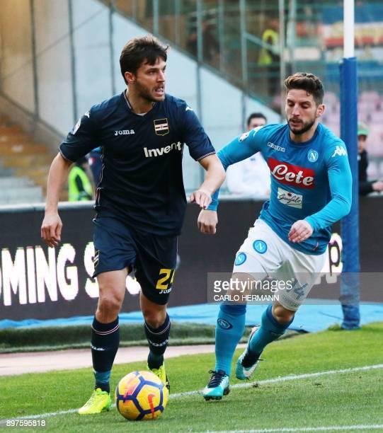 Napoli's Beglian striker Dries Mertens vies for the ball with Sampdoria's Polish defender Bartosz Bereszynski during the Italian Serie A football...