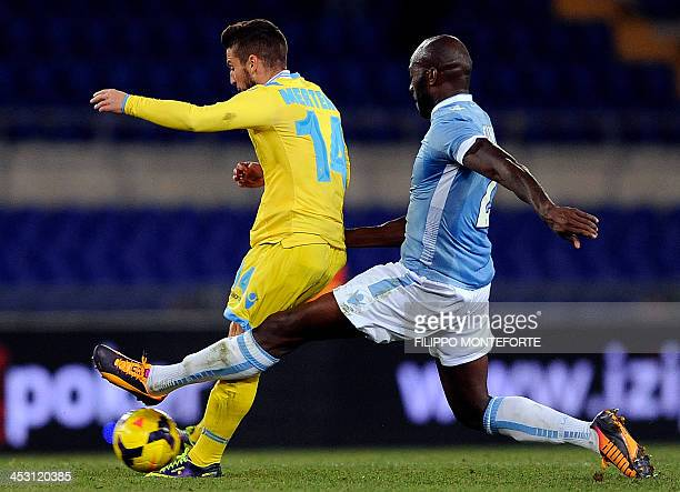 Napoli's Belgian forward Drie Mertens is tackled by Lazio's French defender Michael Ciani during the Serie A football match between the Lazio and...