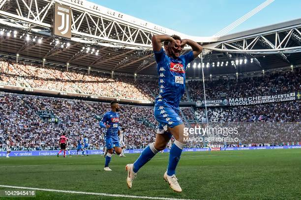 TOPSHOT Napoli's Belgian forward Dries Mertens celebrates after opening the scoring during the Italian Serie A football match Juventus vs Napoli on...