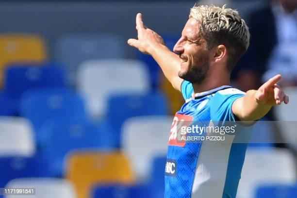 Napoli's Belgian forward Dries Mertens celebrates after opening the scoring during the Italian Serie A football match Napoli vs Brescia on September...