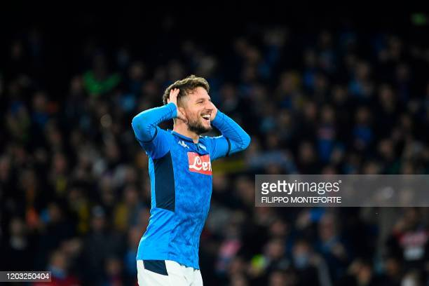 Napoli's Belgian forward Dries Mertens celebrates after scoring a goal during the UEFA Champions League round of 16 firstleg football match between...