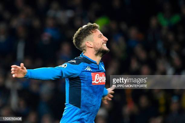 Napoli's Belgian forward Dries Mertens celebrates after scoring a goal during the UEFA Champions League round of 16 first-leg football match between...