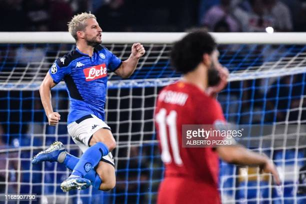 Napoli's Belgian forward Dries Mertens celebrates after scoring a penalty during the UEFA Champions League Group E football match Napoli vs Liverpool...