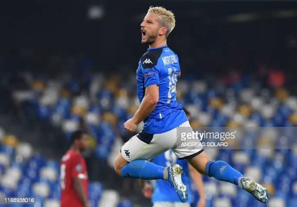 TOPSHOT Napoli's Belgian forward Dries Mertens celebrates after scoring a penalty during the UEFA Champions League Group E football match Napoli vs...