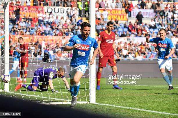 Napoli's Belgian forward Dries Mertens celebrates after scoring during the Italian Serie A football match AS Roma vs SSC Napoli on March 31 2019 at...