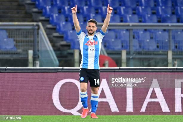 Napoli's Belgian forward Dries Mertens celebrates after scoring his second goal during the Italian Serie A football match AS Roma vs Napoli on March...