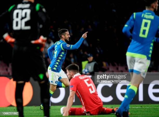 Napoli's Belgian forward Dries Mertens celebrates after scoring the 30 goal during the UEFA Champions League group C football match Napoli vs Red...