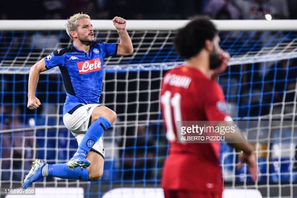 TOPSHOT Napoli's Belgian forward Dries Mertens celebrates next to Liverpool's Egyptian midfielder Mohamed Salah after scoring a penalty during the...