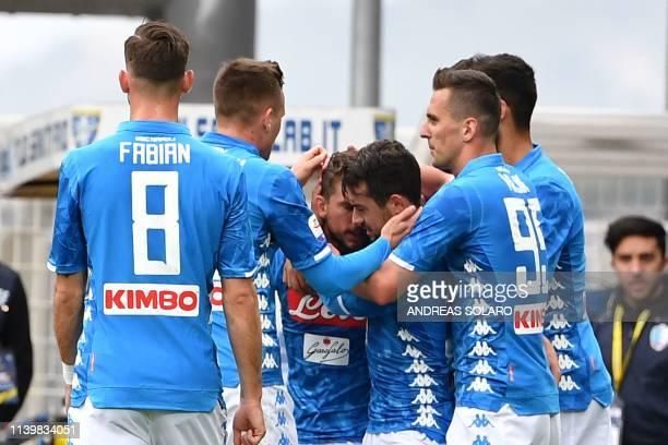 Napoli's Belgian forward Dries Mertens celebrates whit his team mates after scoring, during the Italian Serie A football match Frosinone vs Napoli,...