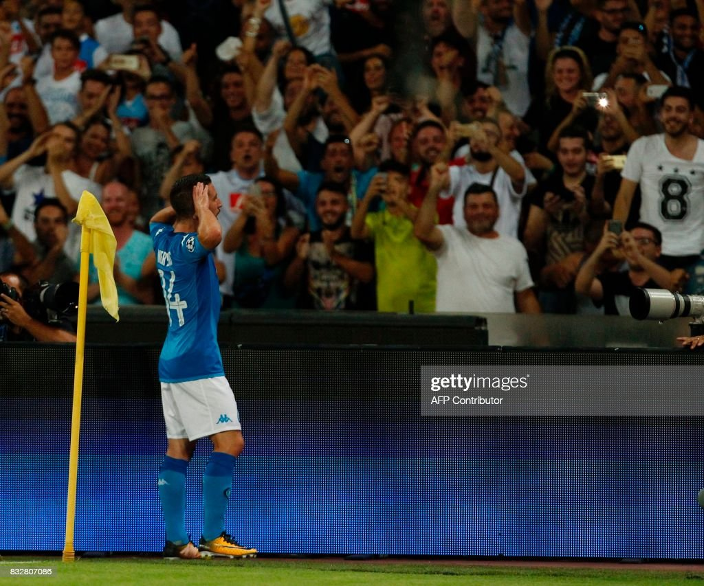 Napoli's Belgian forward Dries Mertens celebrates with fans after scoring during the UEFA Champions League Play Off first leg football match SSC Napoli vs OCG Nice, on August 16 2017 at the San Paolo Stadium. /