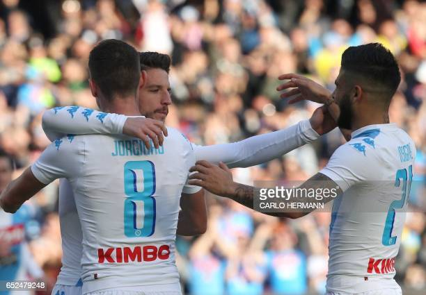 Napoli's Belgian forward Dries Mertens celebrates with Napoli's midfielder from Brazil Jorginho and Napoli's midfielder from Italy Lorenzo Insigne...