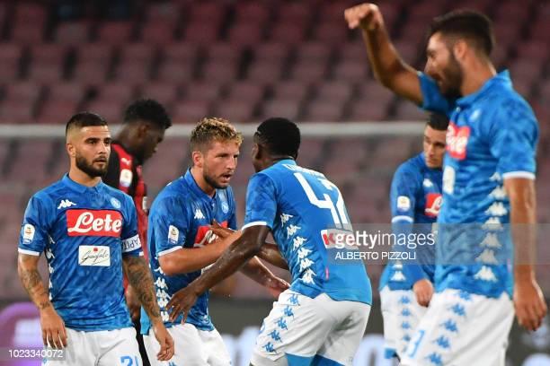 Napoli's Belgian forward Dries Mertens celebrates with Napoli's Guinean midfielder Amadou Diawara as Napoli's Italian forward Lorenzo Insigne looks...