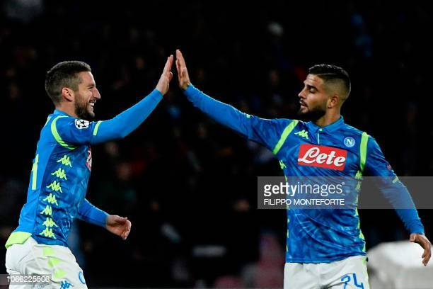 Napoli's Belgian forward Dries Mertens celebrates with Napoli's Italian forward Lorenzo Insigne after scoring during the UEFA Champions League group...