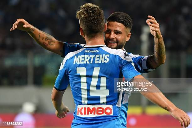 Napoli's Belgian forward Dries Mertens celebrates with Napoli's Italian forward Lorenzo Insigne after scoring an equalizer during the Italian Serie A...