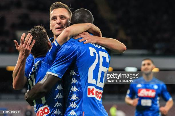 Napoli's Belgian forward Dries Mertens celebrates with Napoli's Polish forward Arkadiusz Milik and Napoli's Senegalese defender Kalidou Koulibaly...