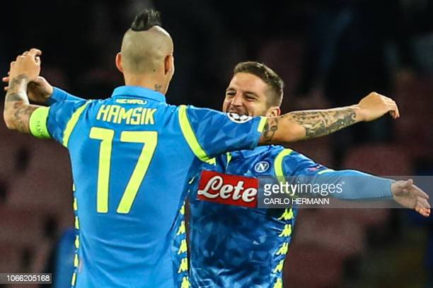 Napoli's Belgian forward Dries Mertens celebrates with Napoli's Slovak midfielder Marek Hamsik after scoring the 30 goal during the UEFA Champions...